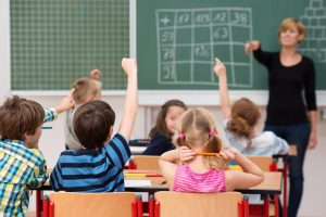 Primary supply teacher in the classroom